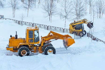 snow clearing: Snowplows on clearing snow drifts. Stock Photo