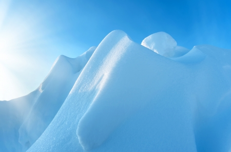 snowdrift: Snow Mountain on a background of blue sky