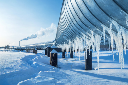 arctic landscape: Gas pipe going to the city boiler