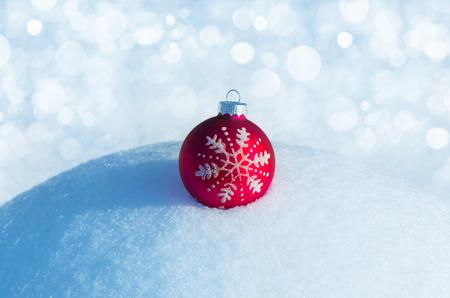 hoar frost: Christmas red ball on snowdrift Stock Photo