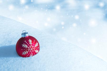 snowdrift: Christmas red ball on snowdrift Stock Photo