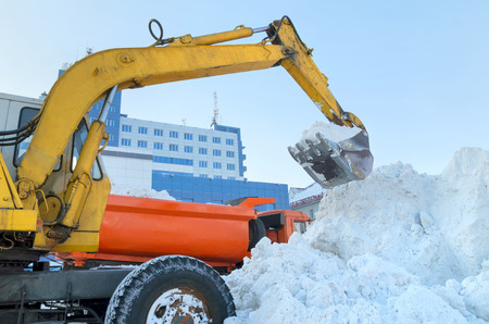 Handling of snow excavator photo