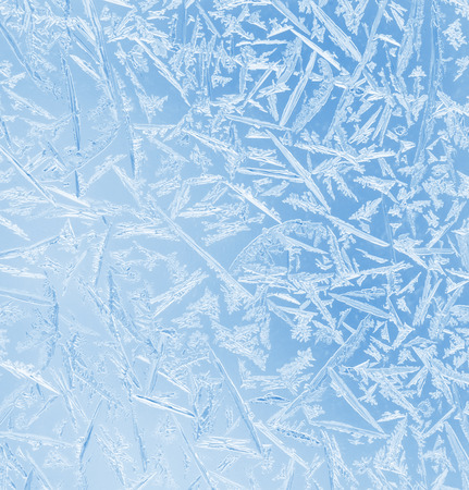 winter thaw: Abstract frosty pattern on glass. Stock Photo