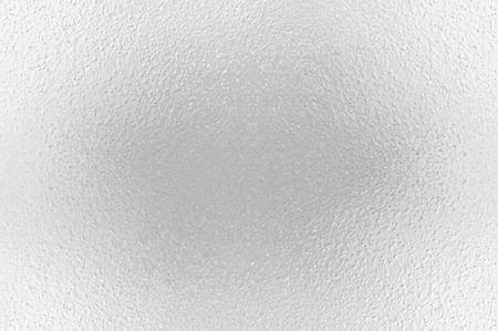 La surface gelée du verre dans les tons de gris