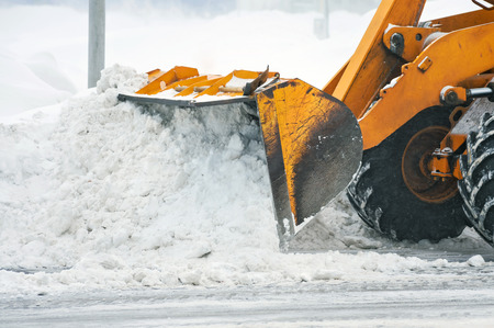 Clearing snow after a storm photo
