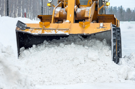 wheel loader: The bulldozer cleans the road after a blizzard Stock Photo