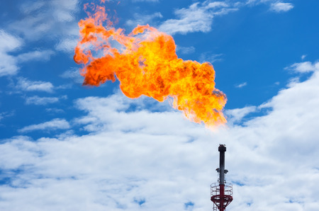 Gas flaring. Torch against the sky. 写真素材