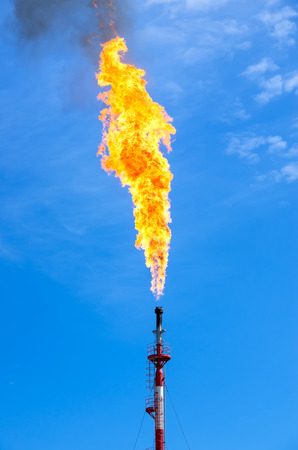 annihilation: Gas flaring. Torch against the sky. Stock Photo