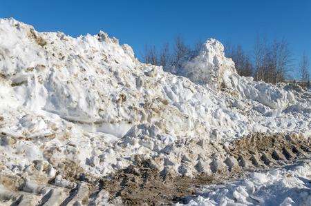 heap of snow: Heap of dirty snow Stock Photo