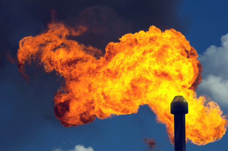 and is favorable: Flame in the sky from burning of associated gas at oil production