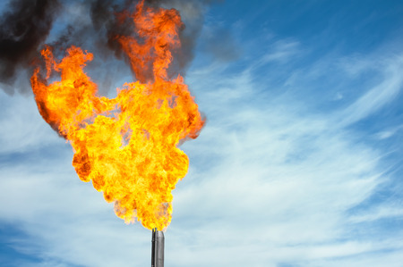 torch: Gas flaring. Torch against the sky. Stock Photo