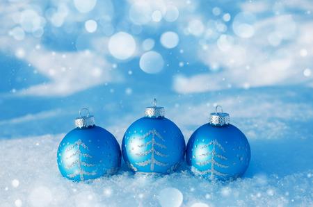 blue ball: Three blue Christmas ball on snow background