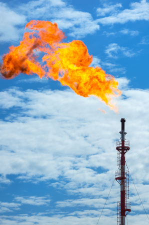 gas fire: Gas flaring. Torch against the sky. Stock Photo