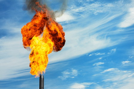 Gas flaring. Torch against the sky. Stock Photo