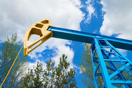 chink: Oil pump on a background of the sky with clouds