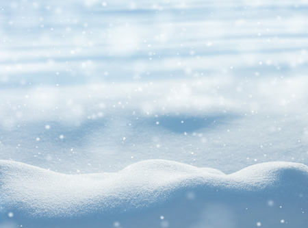 Natural winter background with snow drifts and falling snow