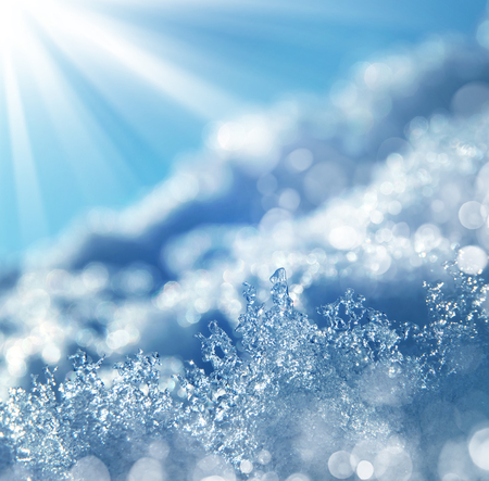 Winter background with transparent ice crystals.