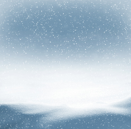 snow falling: Winter background with snowdrifts and the falling snow