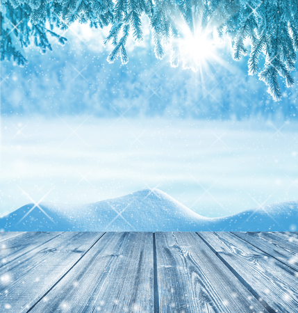 Winter background with a wooden table in the foreground