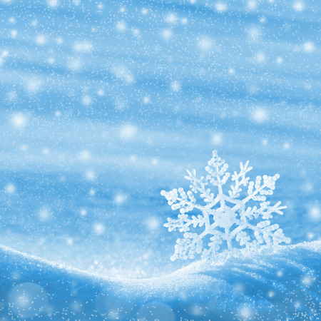 snowflake snow: Christmas background with a decorative snowflake on brilliant snow