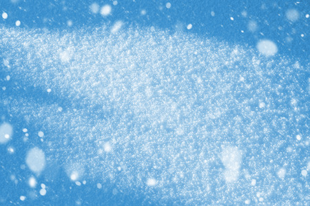 Winter background with shiny snow and blizzard