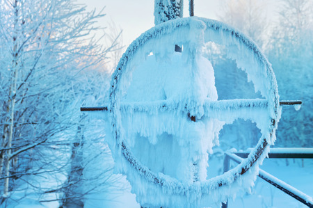 chink: Gas pipelines with latch covered with snow and hoarfrost