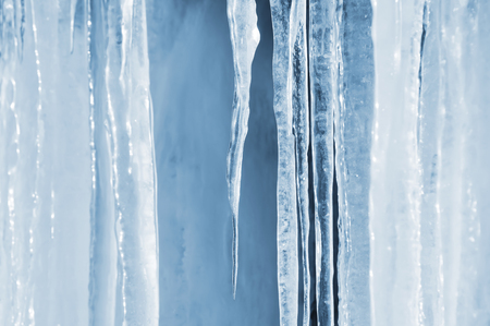 crystal background: Background of bright transparent icicles in the sunlight