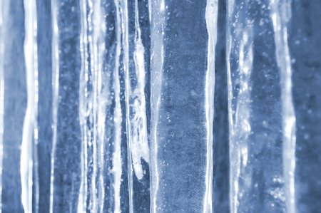 ice crystal: Background of ice transparent thick icicles close-up Stock Photo