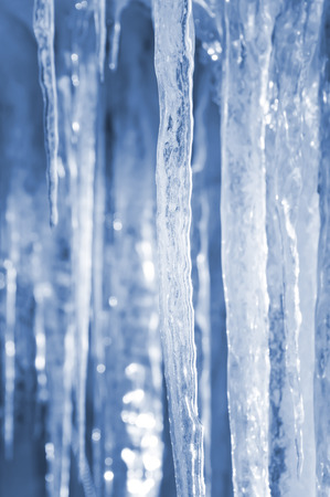 ice crystal: Bright spring background with icicles in the sunlight Stock Photo