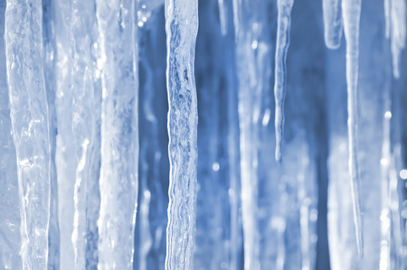 ice crystal: Background of bright transparent icicles in the sunlight