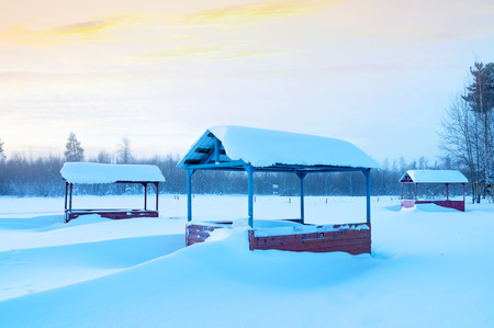 Winter morning landscape with snow-covered arbors for rest Stock Photo
