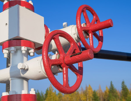 oil and gas industry: The gas control valve on background of blue sky