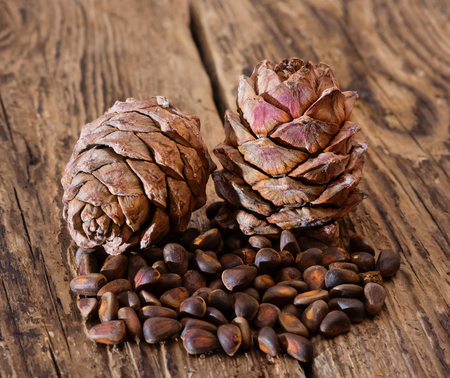 Cedar cones with nuts on an old table