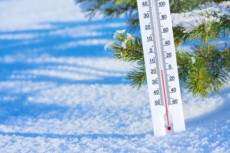 Wintertime. Winter background with  thermometer in the snow on frosty day. Stock Photo