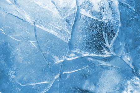 Abstract ice background. Blue background with cracks on the ice surface Banco de Imagens