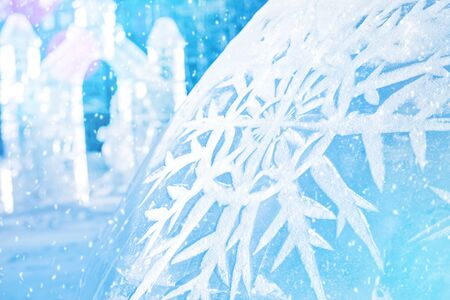 Winter background. Drawn snowflake on the background of ice sculptures