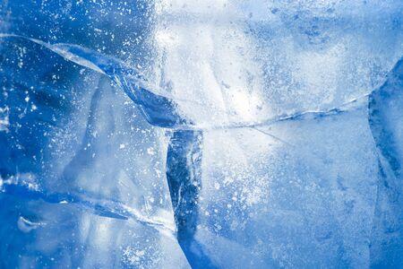 Ice background. Pattern of transparent shiny ice. Natural bright background Standard-Bild
