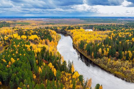 Colorful autumn landscape. Aerial photography of landscape in Western Siberia. Agan River, tributary of Ob River.
