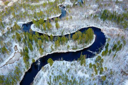 Winter landscape. Aerial view. Landscape with  winding freezing river Standard-Bild