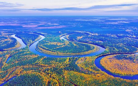 Aerial photography of landscape in Western Siberia. Agan River, tributary of Ob River. Autumn landscape