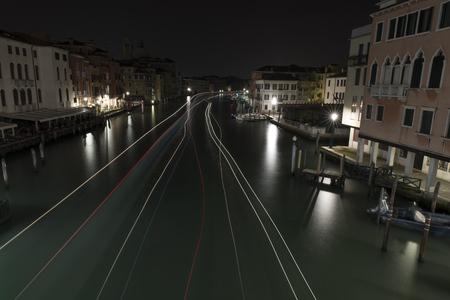 Boat Trail of Lights in Grand Canal, Ponte Degli Scalzi, Rialto Bridge, Venice, Italy