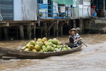 Coconut on a boat with coconuts in a floating market on the Mekong river in Vietnam