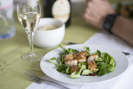 Grilled Fresh Scallop on salad. Closeup of seared scallops. Seafood from Normandy is delicious and perfect for christmas