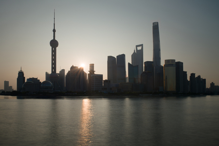The Bund early in the morning at sunrise. View of Pudong and Huangpu river from The Bund in Shanghai, China