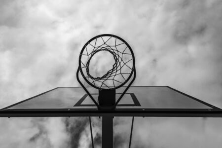 basketball hoop in a community park waiting for the storm to start with a dramatic sky in Spain
