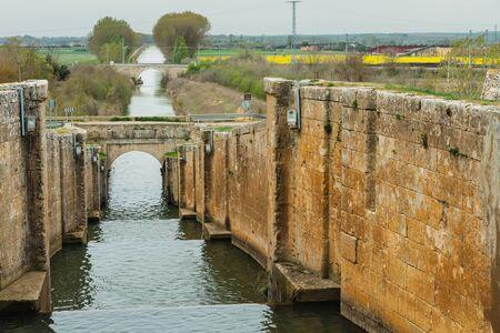 lock gates of the canal de castilla, castile channel, palencia, spain