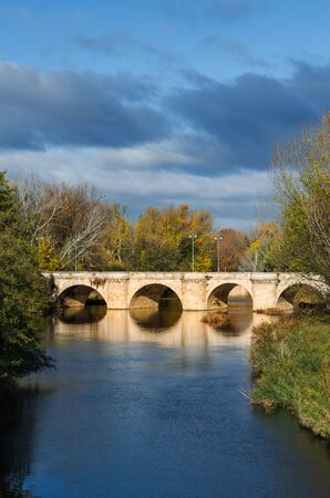 medieval stone bridge, puente mayor, crossing carrion, palencia, spain