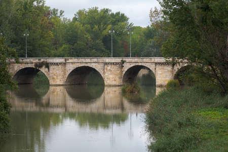 ashlar stone medieval bridge, puente mayor, crossing carrion, in autumn