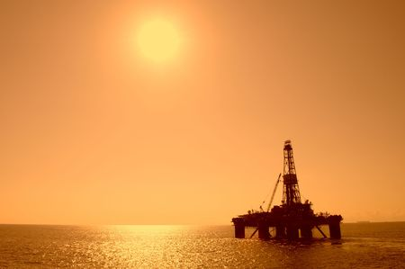 oilrig: Silhouette of an oil drilling rig. Coast of Brazil.