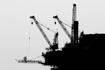 silhouette of an offshore oil rig, isolated on a white background Stock Photo - 7998471